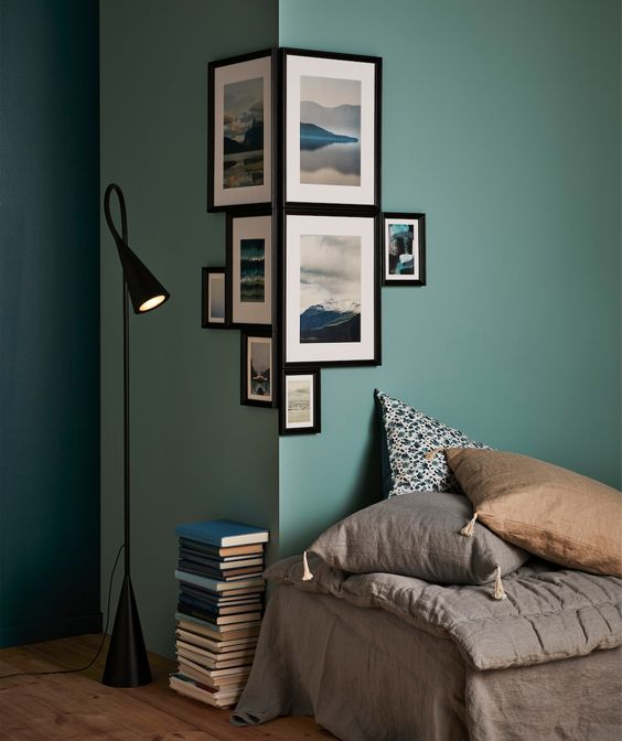 black floor lamp, green sage wall, brown bed