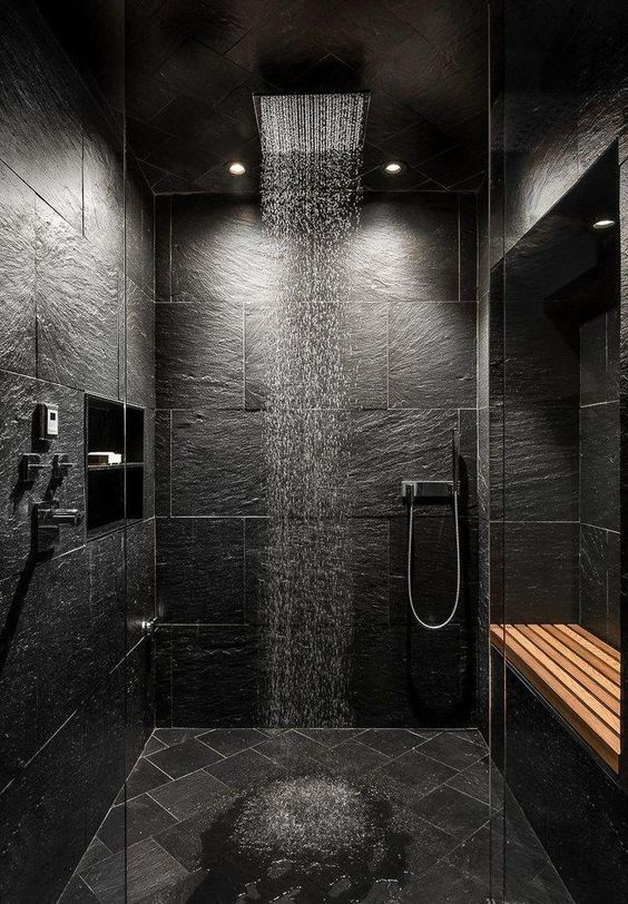 black stone marble wall, vertical shower, wall nook, wooden shelves, built in shelves