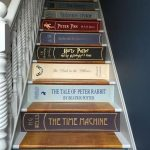 Books Cover Sticker On The Stairs, White Wooden Rail, Dark Blue Wall
