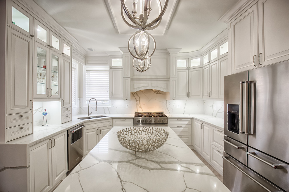 corner kitchen sink cabinet pendant lamps white marble backsplash white cabinets refrigerator white marble countertops oven glass shelves windows drawers