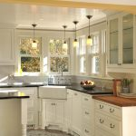 Corner Kitchen Sink Cabinet Pendant Lamps Windows Glass Cabinet Doors Stove Oven White Drawers Black Countertip White Island Stool Kitchen Mat