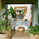 Entrance, White Wall, Green Entrance Wall, Rattan Pot, Welcome Mat, Wooden Terrace Floor, Brown Floor, Grey Console Table, Mirrpr