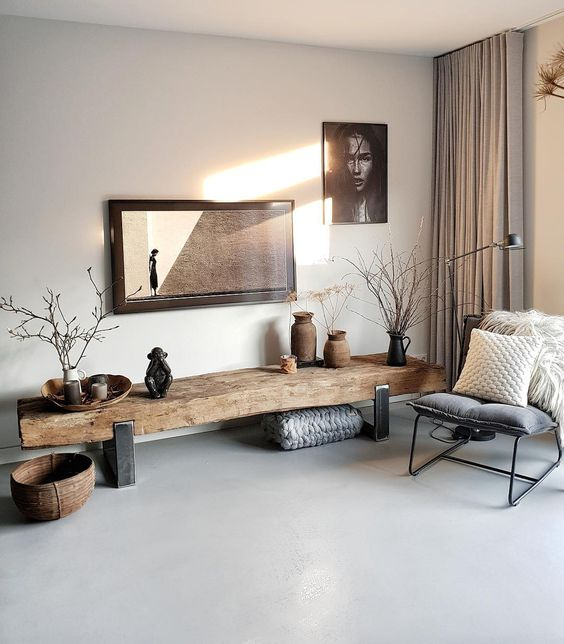 grey seamless floor, white wall, long wooden bench with metal legs, grey chair, metal lamp