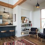 Living Room, Wooden Floor, Patterned Rug, White Wall, Blue Kitchen, Blue Pattered Chairs, Floating Shelves, Black Pendants