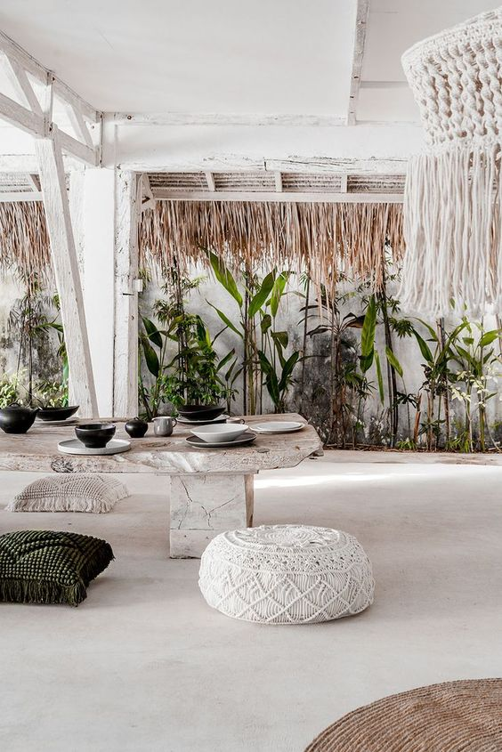outdoor dining space, white stone dining table, pillows, white seamless outdoor floor, white ceiling, white macrame pendant