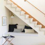 Seats Under The Stairs, White Wall, White Bench, White Stairs, White Cushion, White Bulb Sconce, Foldable Side Table