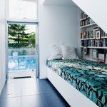 Seats Under The Stairs, White Wall, White Bookshelves, Green Patterned Cushion