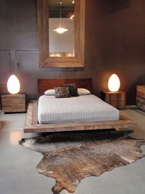 wooden box platform with white linen, wooden headboard, grey seamles floor, dark wall