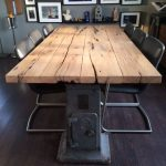 Wooden Dining Table, Metal Legs, Black Chair With Metal Legs, Wooden Floor, Grey Wall