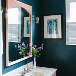 Bathroom, Dark Green Wall, Pink Cabinet, Pink Framed Mirror, White Top