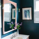 Bathroom, Dark Green Wall, Pink Cabinet, Pink Framed Mirror, White Top