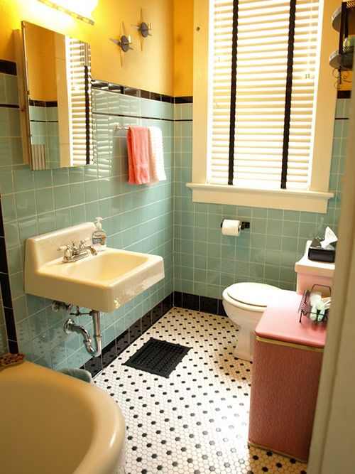 bathroom, green wall tiles, yellow wall, pink basket, white toilet, white sink, white sink