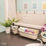 Bathroom, Grey Floor, White Bath Tub, Blue Wall, Storage On The Rod