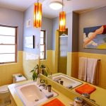 Bathroom, Hexagonal Floor Tiles, Yellow Square Wall Tiles, Yellow Vanity, White Sink, Orange Pendant, Grey Wall, Large Mirror