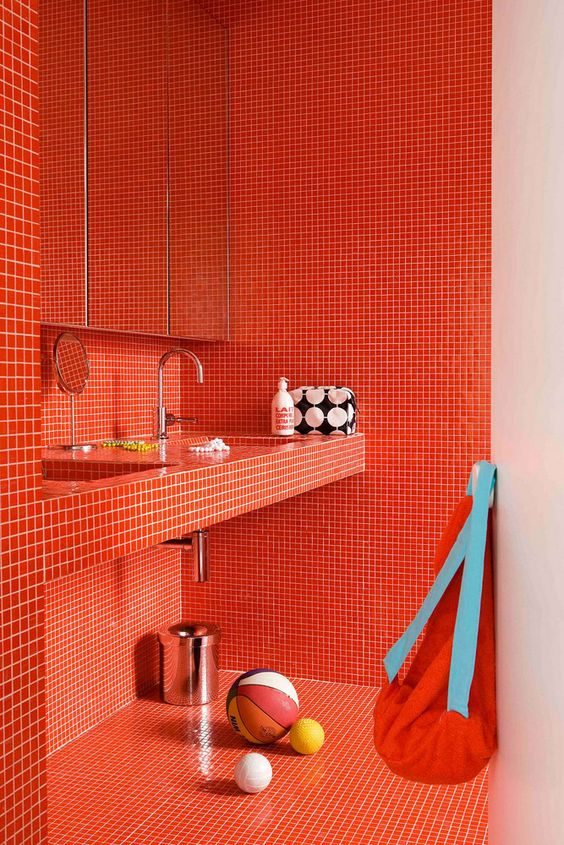 bathroom, red tiny square tiles on wall and floor, floating vanity, mirror with storage behind