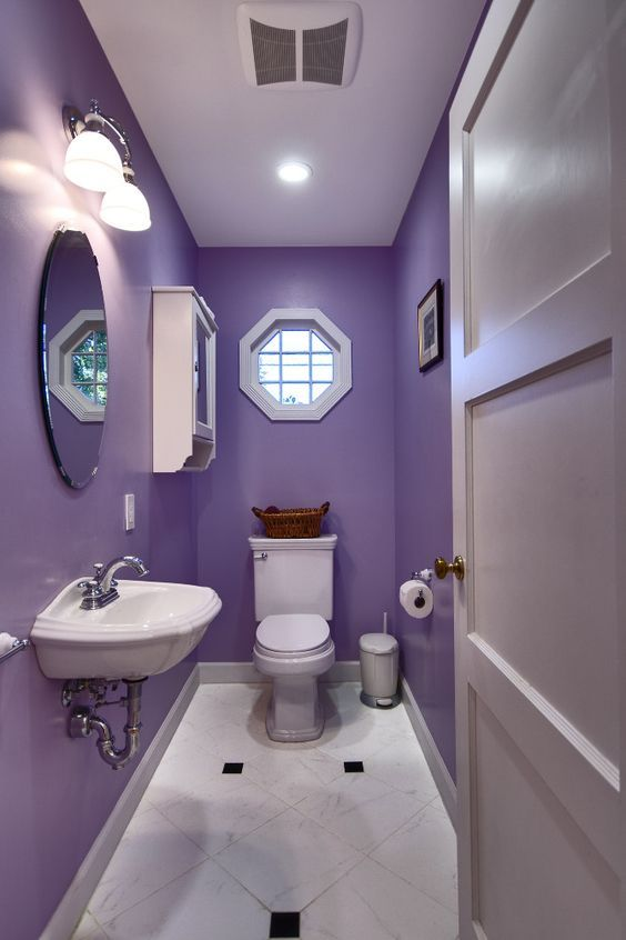 bathroom, white floor tiles, purple wall, white toilet, white sink, mirror, sconce