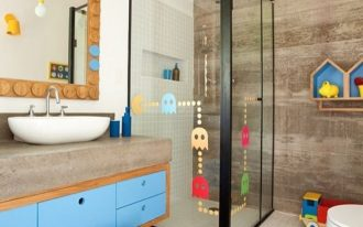 bathroom, white floor tiles, white wall tiles, floating wooden cabinet, wooden stair stool, pacman sticker, house shelves