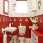 Bathroom, White Floor With Red Pattern, Red Wainscoting Wall With White Patterns, White Wall, White Toiet With Red Lid, White Sink