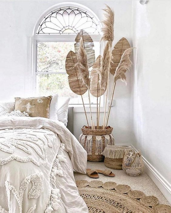 bedroom, brown floor, rattan rug, white wall, rattan pots, white linen, window, woven linene
