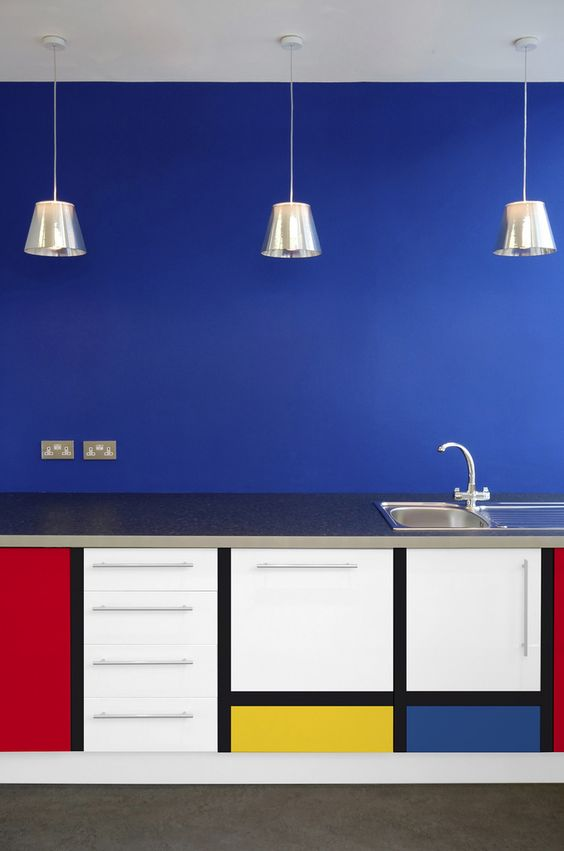 bedroom, grey floor, blue wall, cabinet with pop art, silver pendants, silver kitchen top