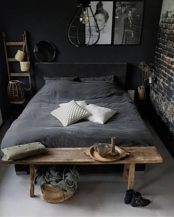 bedroom, grey floor, grey wall, exposed, grey bed, wooden bench, black metal pendant