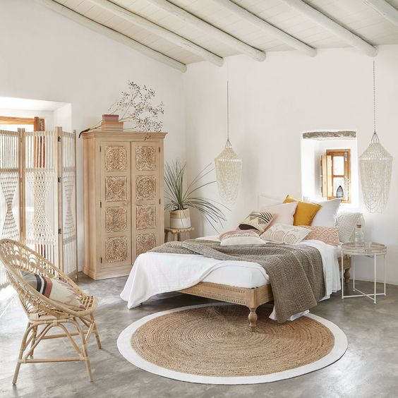 bedroom, grey seamless floor, white wall, wooden bed platform, white wall, white wooden beam ceiling, rattan chair, wooden cupboard