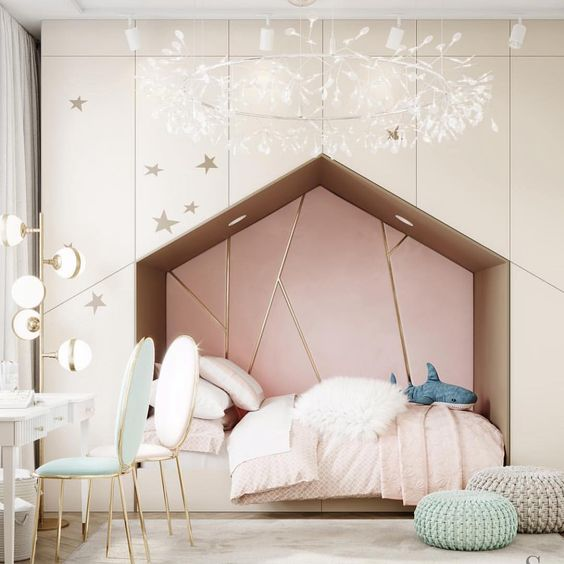 bedroom, white bilt in cupboard, pink inside wall, wooden floor, white rug, make up station, white chair, green chair, white chandelier