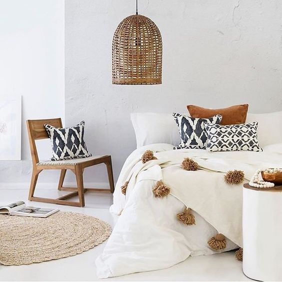 bedroom, white floor, white linen, white wall, wooden chair rattan seating, rattan pendant, rattan rug
