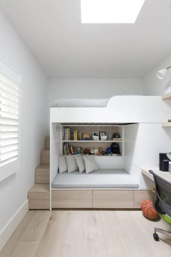 bedroom, wooden floor, bunk bed, shelves and seating nook under, floating study table, drawer, white wall