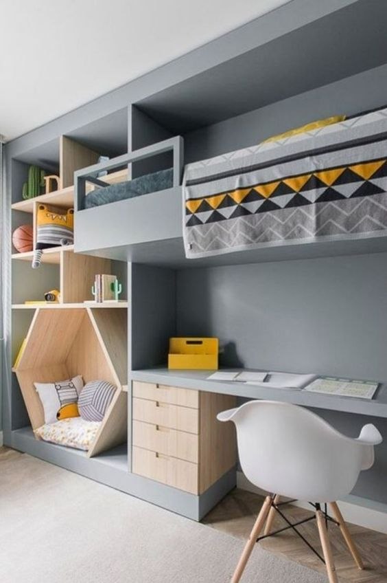 bedroom, wooden floor, grey rug, grey wall, floating built in bed, built in shelves, sitting nook, built in study