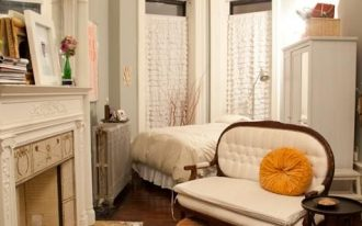 bedroom, wooden floor, grey wall, white bed, white classic chair, white fireplace with details,