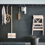 Black Wooden Wall, Blue Wall, Hooks, Grey Flor