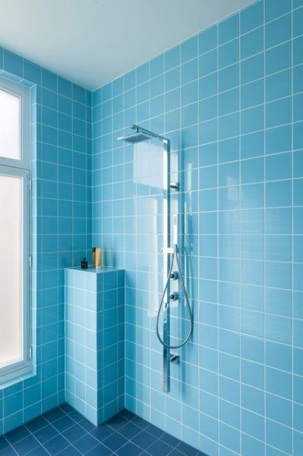 blue wall tiles, dark blue floor tiles, shower