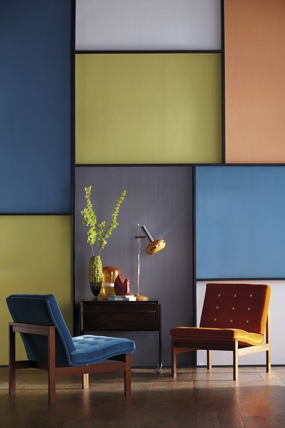 brown floor, blue chair, yellow chair, soft colorful wall, wooden low cabinet