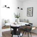 Dining Nook, Wooden Floor, White Wall, Black Sconces, Floating Wooden Bench, White Round Table, Black Chairs