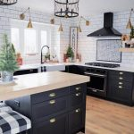 Farmhouse Kitchen, Wooden Floor, Black Bottom Cabinet, White Top, White Subway Wall Tiles, Golden Sconces, Black Cage Pendants, Black Island, Wooden Top