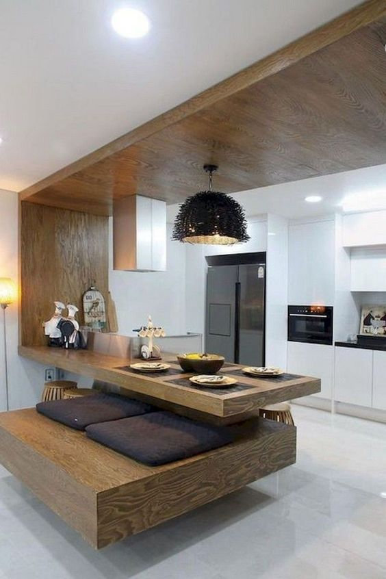 floating wooden kitchen island from the ceiling, wooden platform with cushion, white floor, white cabinet