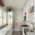 Galley Kitchen, Black White Floor Tiles, White Cabinet, Grey Marble Top, Grey Marble Backsplash, Blue Wall