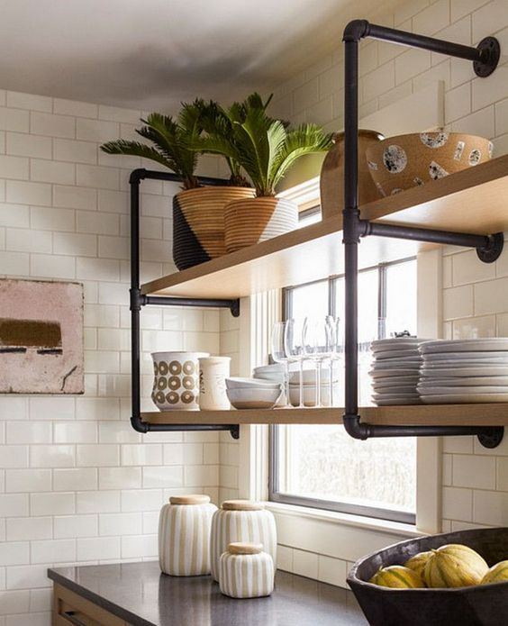 kitchen, black top, white subway wall tiles, wooden board shelves with black metal support