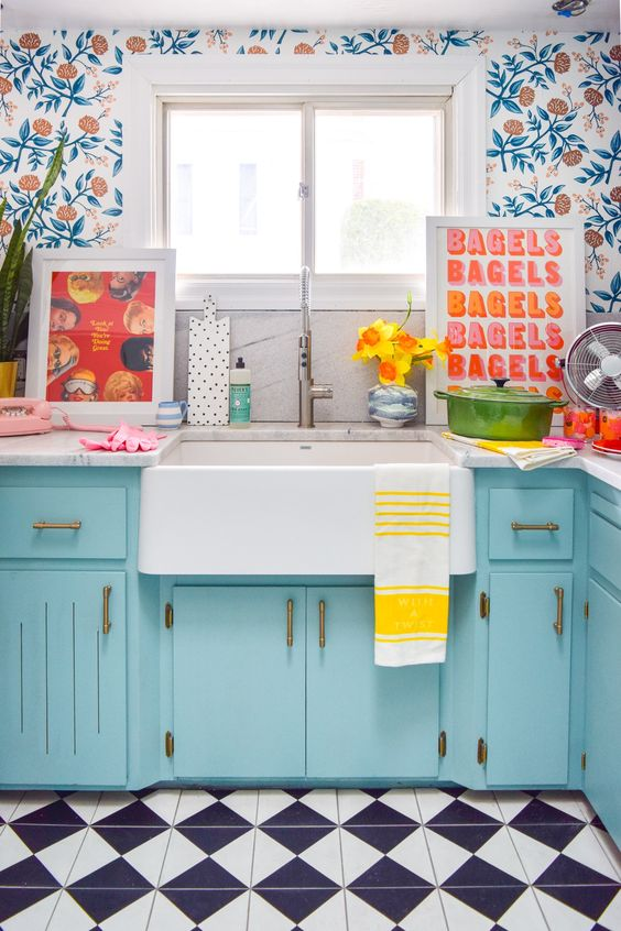 kitchen, black white checkered floor, flowery wallpaper, blue cabinet, white top, white sink