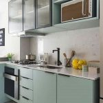 Kitchen, Grey Floor, White Backsplash, Green Bottom Cabinet, Green Upper Cabinet, White Marble Top