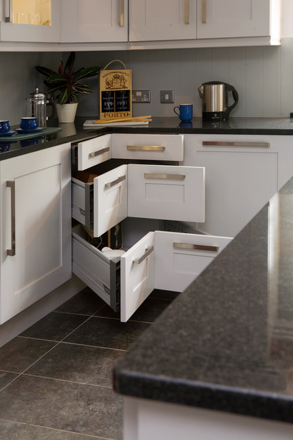 kitchen, grey marble floor tiles, white cabinet, silver handler, grey backsplash wall, black marble top