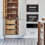 Kitchen, Patterned Floor Tiles, White Built In Cupboard, Drawers, Shelves Inside
