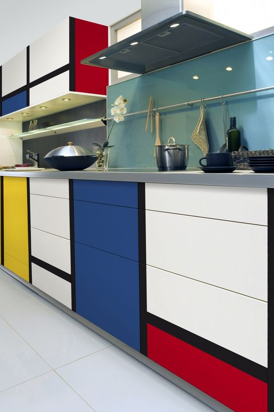 kitchen, white floor, cabinet with colorful blocks pop art, blue backsplash