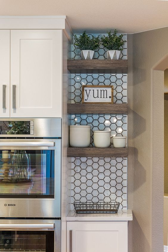 kitchen, white hexagonal wall tiles, white cabinet, shelves in the corner