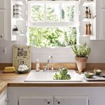 Kitchen, White Wall, White Bottom Cabinet, Wooden Top, White Small Shelves Near The Window