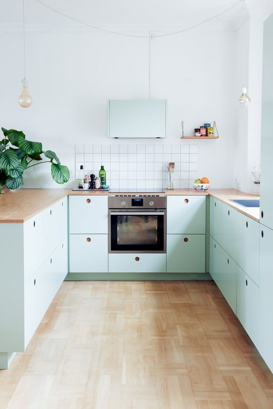 kitchen, wooden floor, light green bottom cabinet, white backsplash, white wall