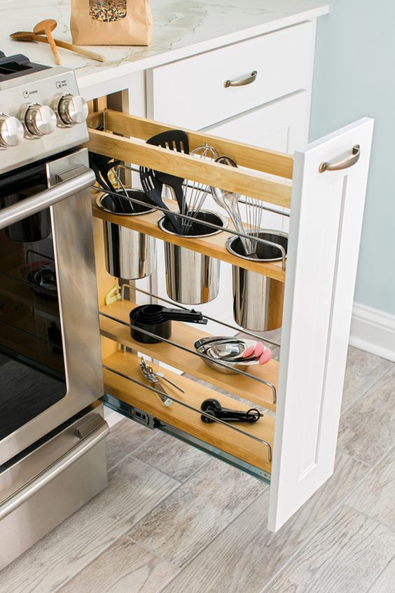 kitchen, wooden floor, light wall, white bottom cabinet, pull out storage for kitchen stools