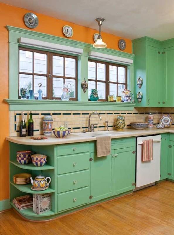 kitchen, wooden floor, orange wall, green cabinet wooden top, green wooden framed window, brown backsplash floor tiles