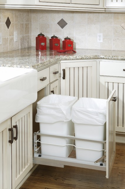kitchen, wooden floor, white cabinet, marble top, trash chute inside the cabinet